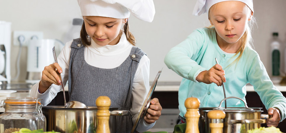 two young chefs cooking