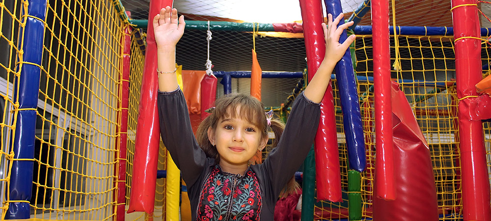 child on indoor playscape