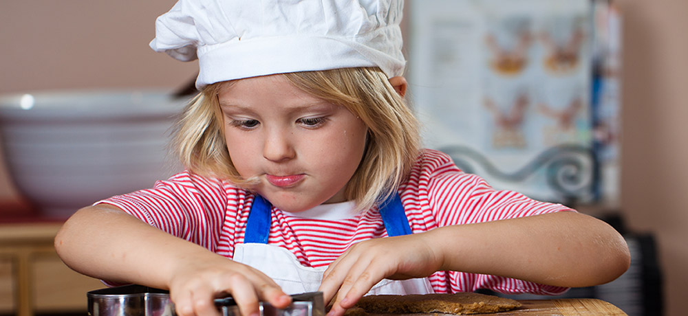 young girl cooking in vacation program
